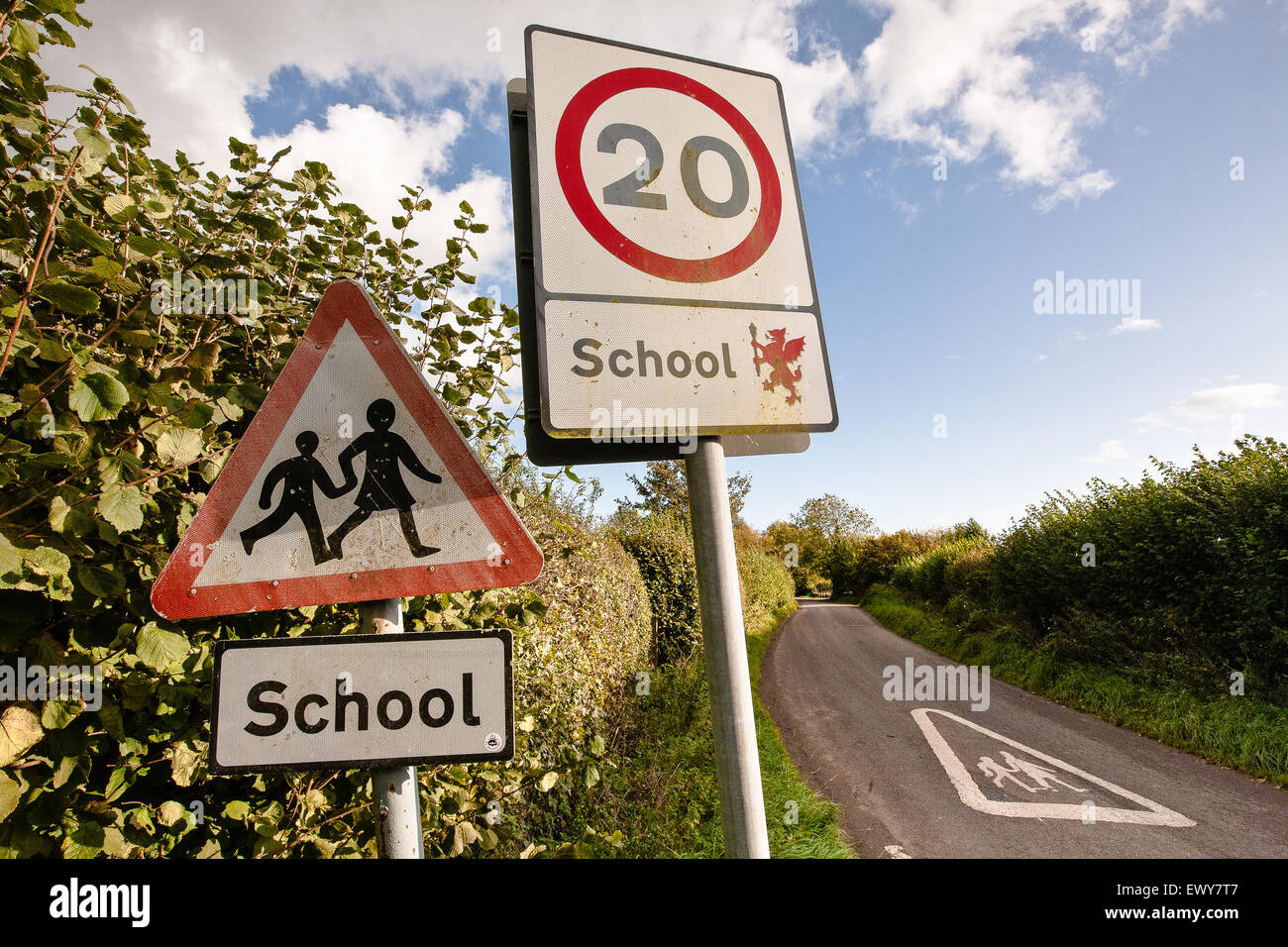 Road /traffic sign to reduce the speed limit on this country lane near a school, Horsington village, South Somerset, - Stock Image