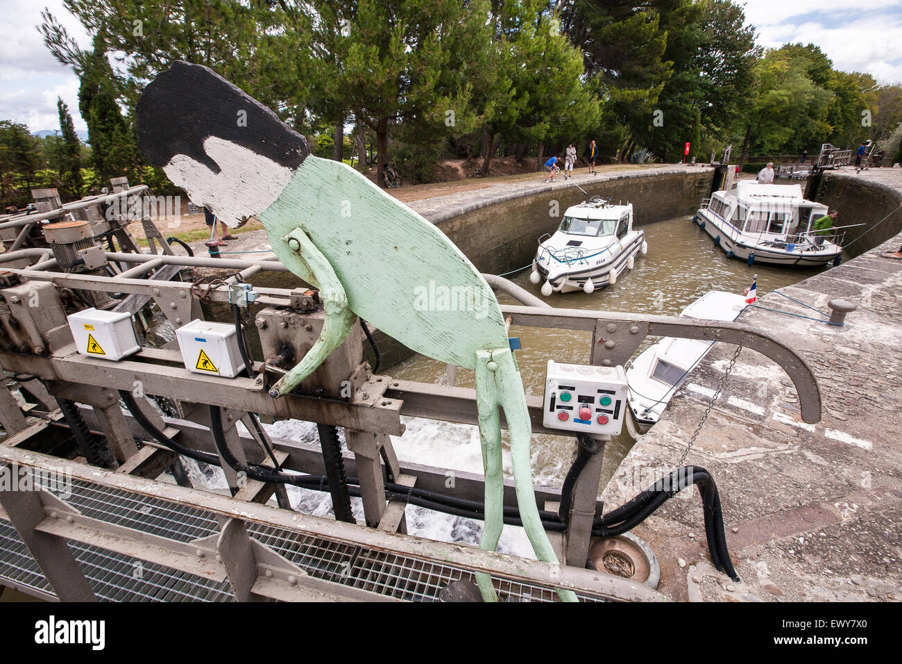Cruise boats at lock on popular Canal du Midi, France. July. The Canal du Midi is a 240 kms long canal in Southern - Stock Image
