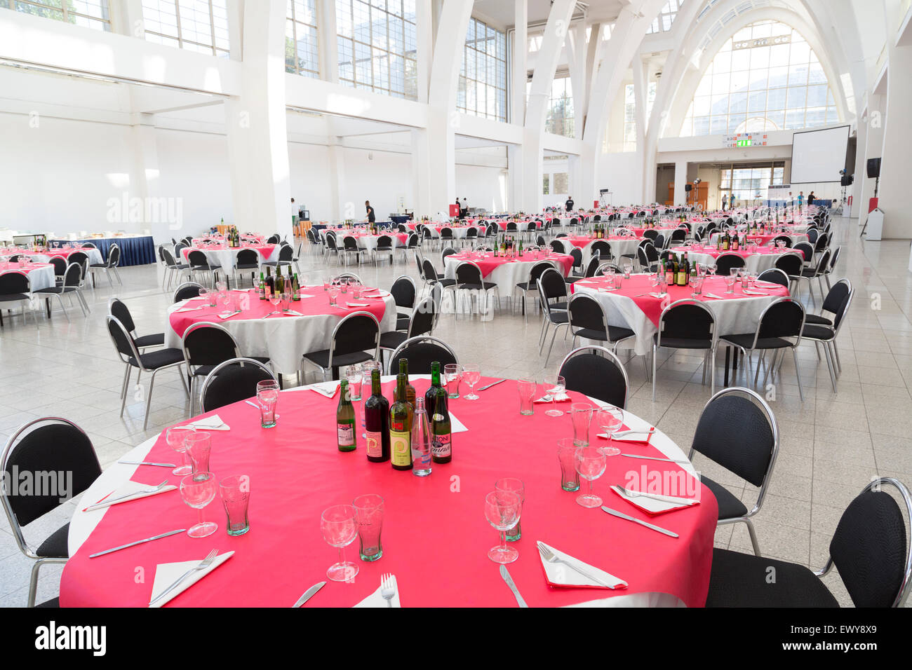 Tables laid ready for conference dinner with wine on each table, Brno, Czech Republic - Stock Image