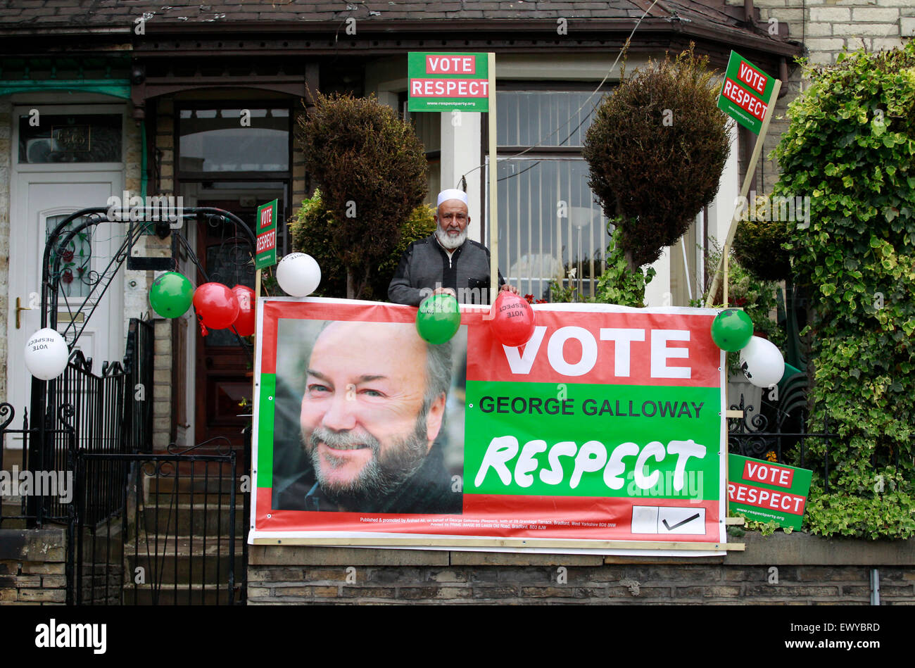 A Respect Party supporter,  Mr Faqir-Ur-Rahman of Whetley Hill, Bradford, with a George Galloway banner outside Stock Photo