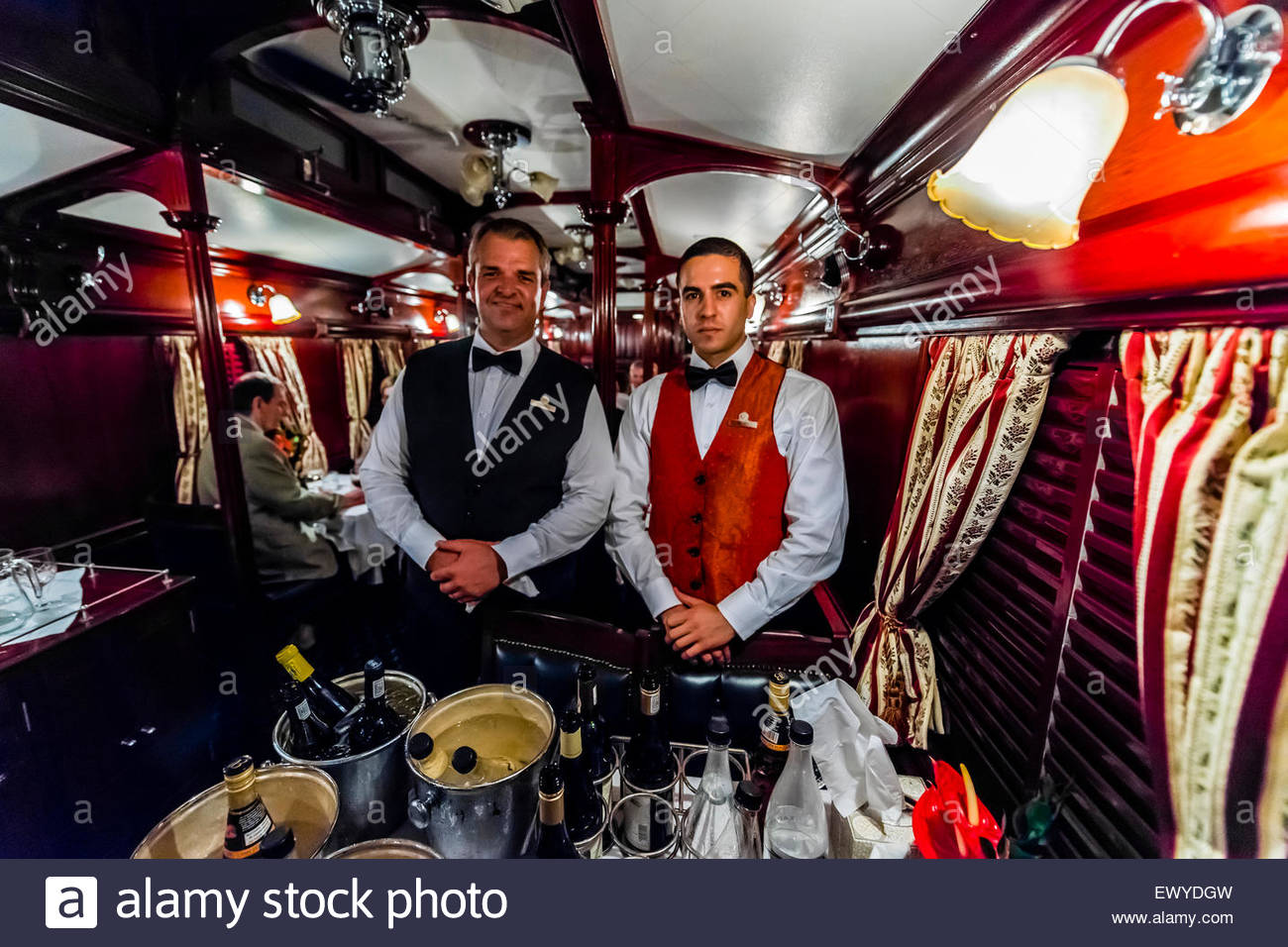 Passengers having dinner in a pillared pre-1940s dining car on the luxury Rovos Rail train between Pretoria and - Stock Image
