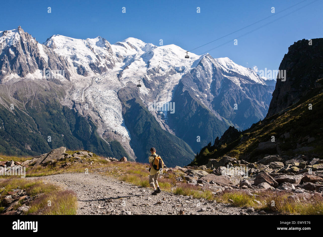 Hiking above Chamonix Mont Blanc valley, France. Mont Blanc mountain in background. Stock Photo