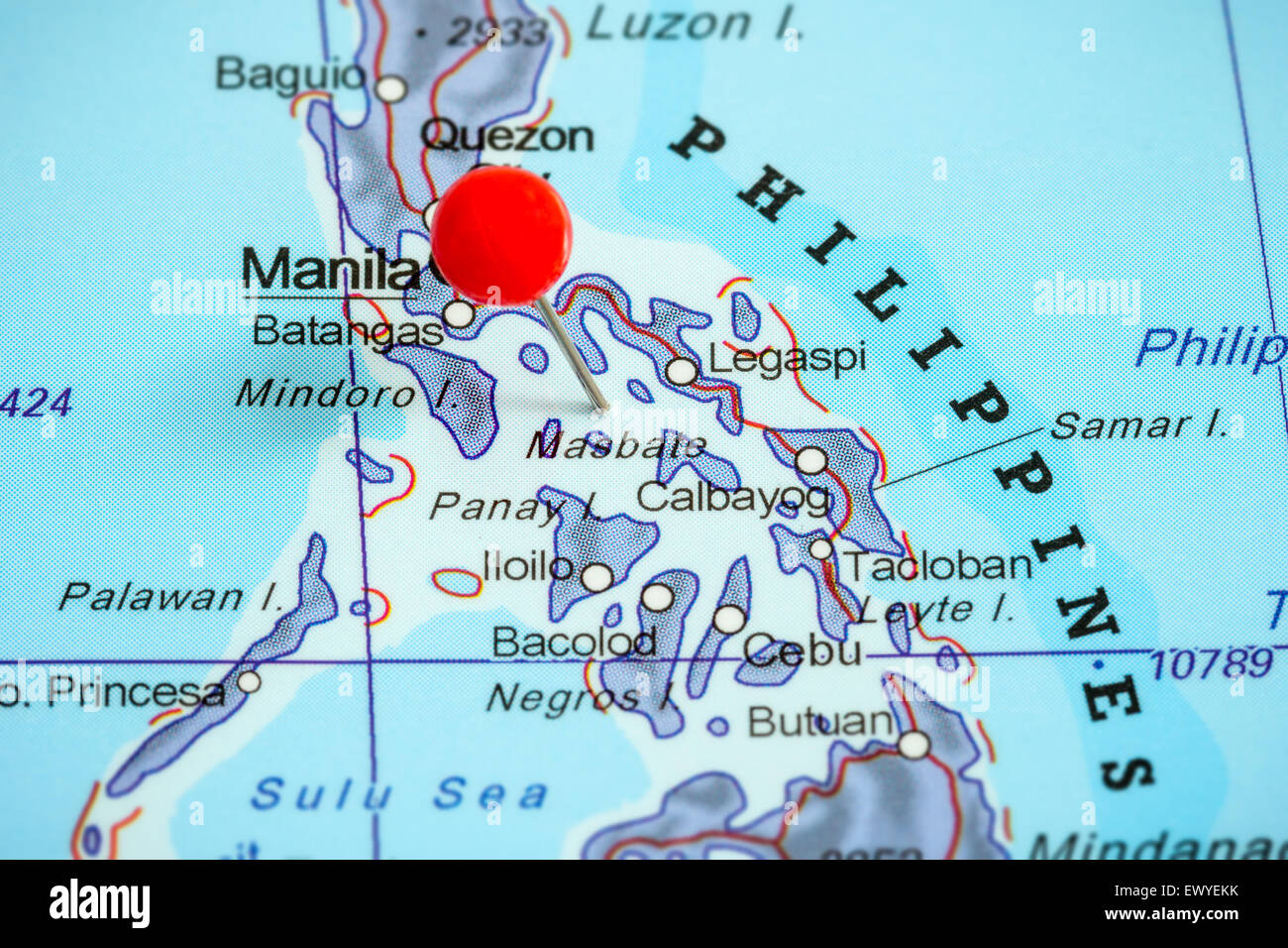 Close-up of a red pushpin on a map of Philippines Stock Photo