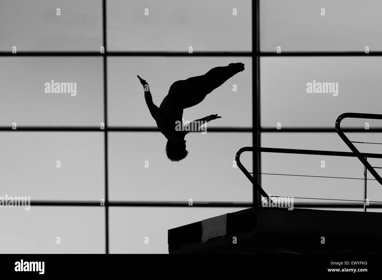 The silhouette of a diver competing on the 10M board at the Diving World Series in London on May 2, 2015. - Stock Image