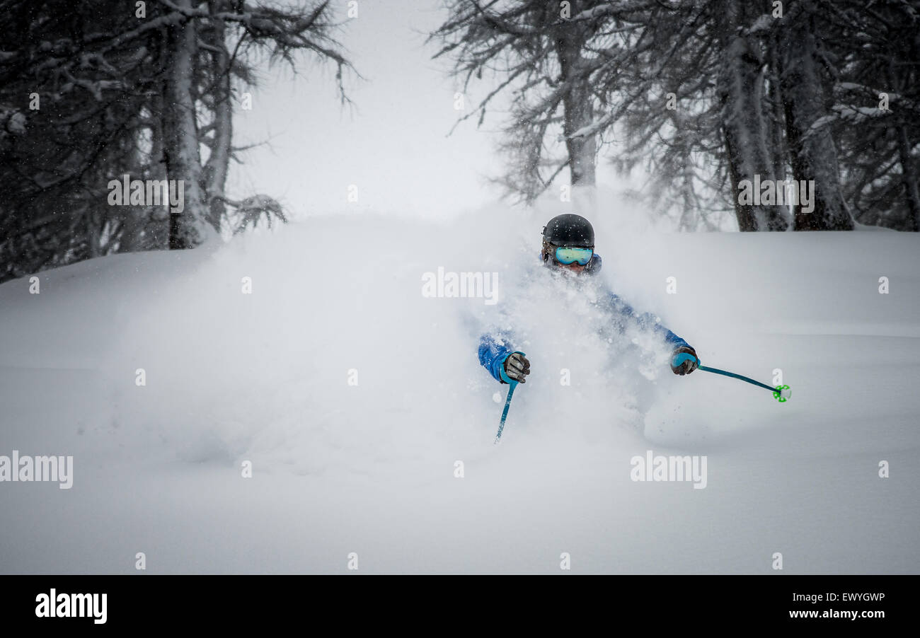 Young man Deep powder skiing in Austria - Stock Image