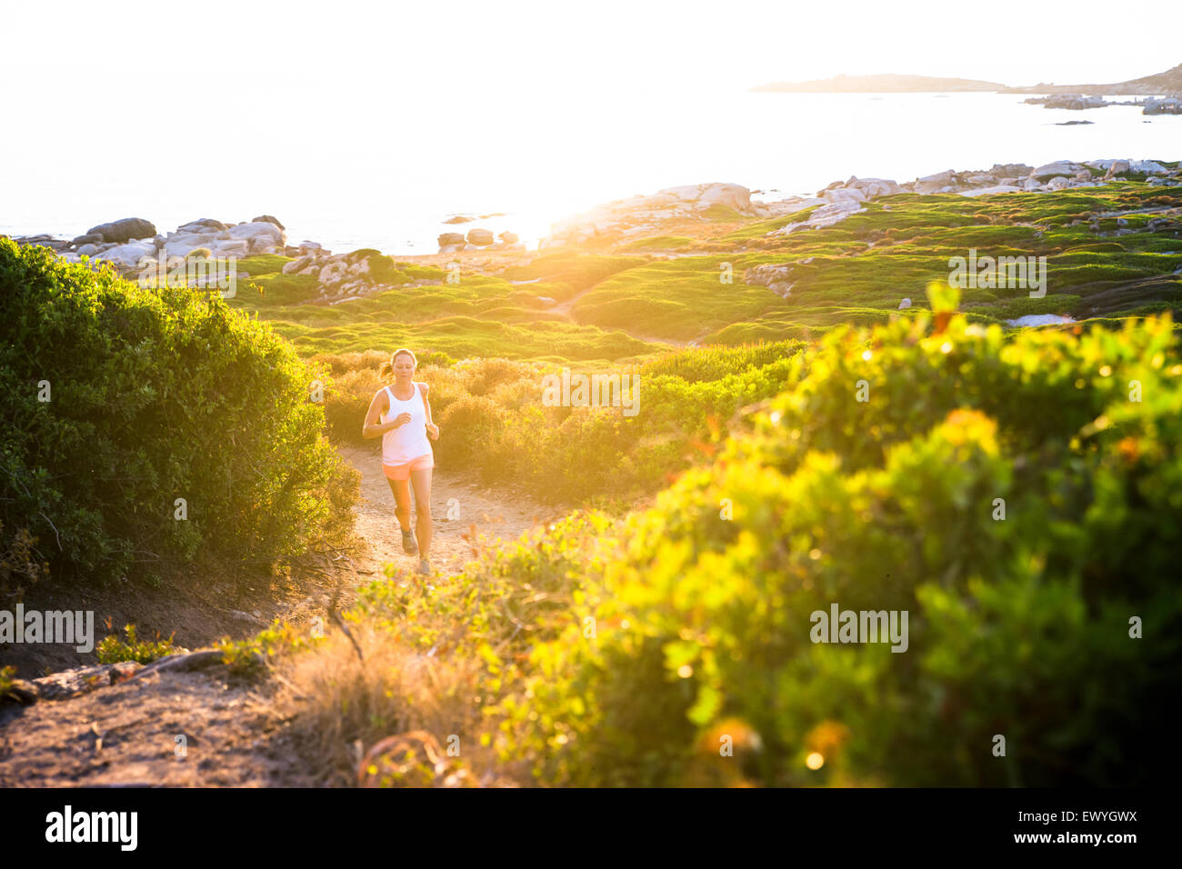 Girl jogging on trail, Corsica, France - Stock Image