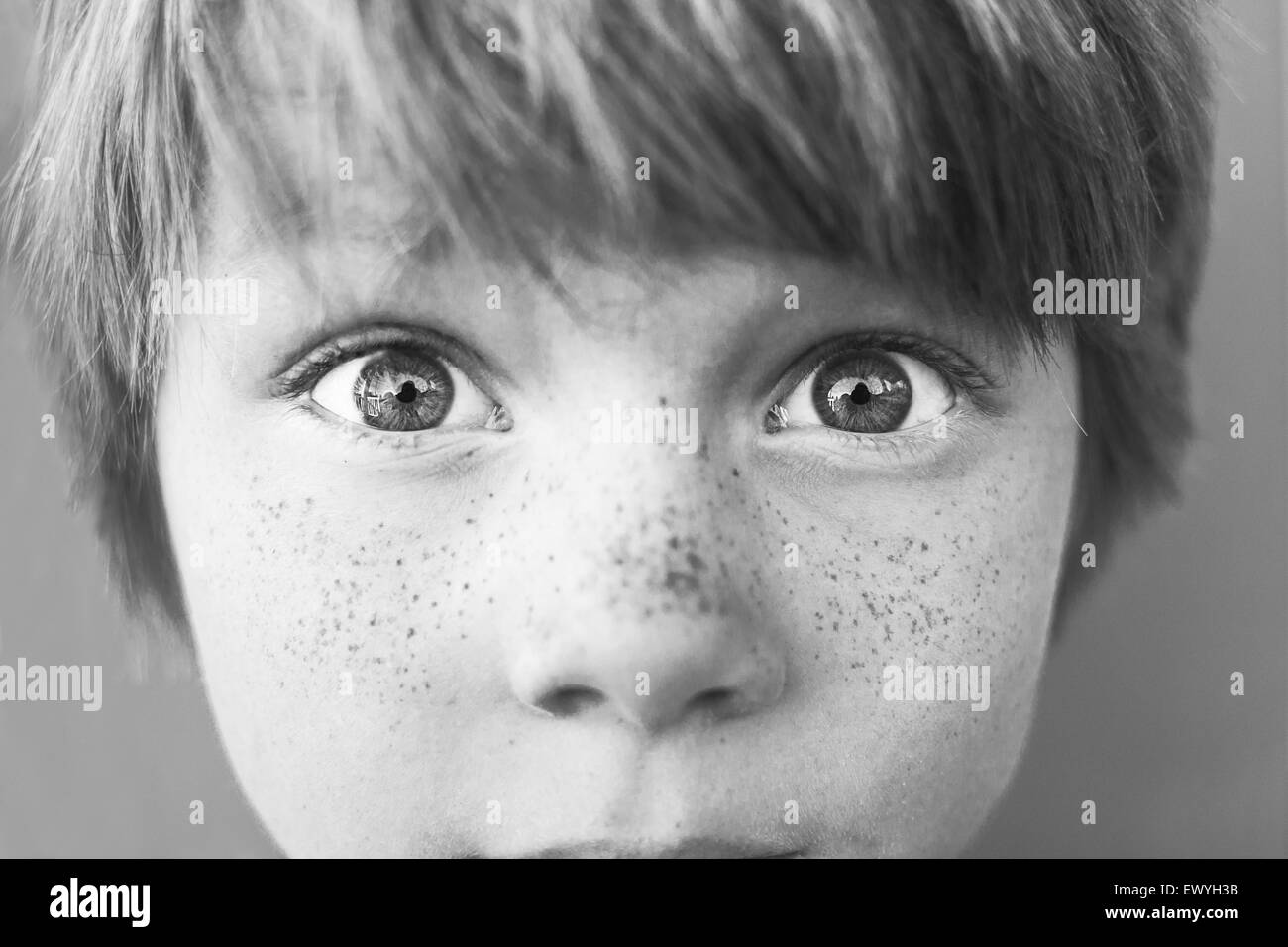 Close-up portrait of a boy with freckles - Stock Image