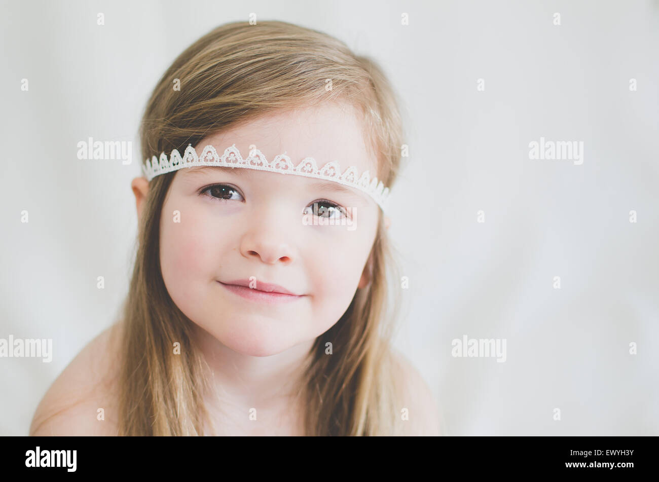 Portrait of a girl wearing a lace headband - Stock Image