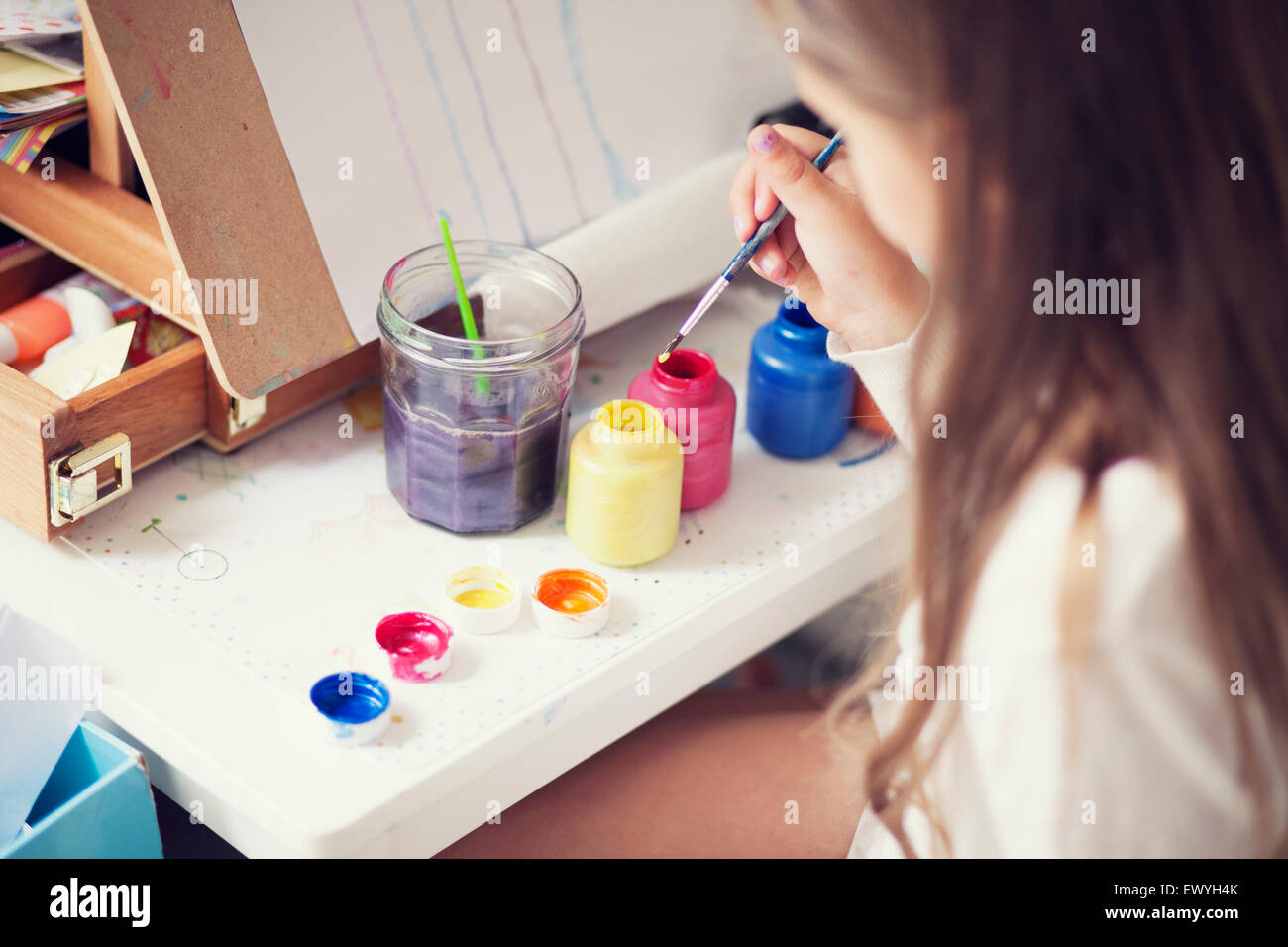 Elevated view of a girl painting - Stock Image
