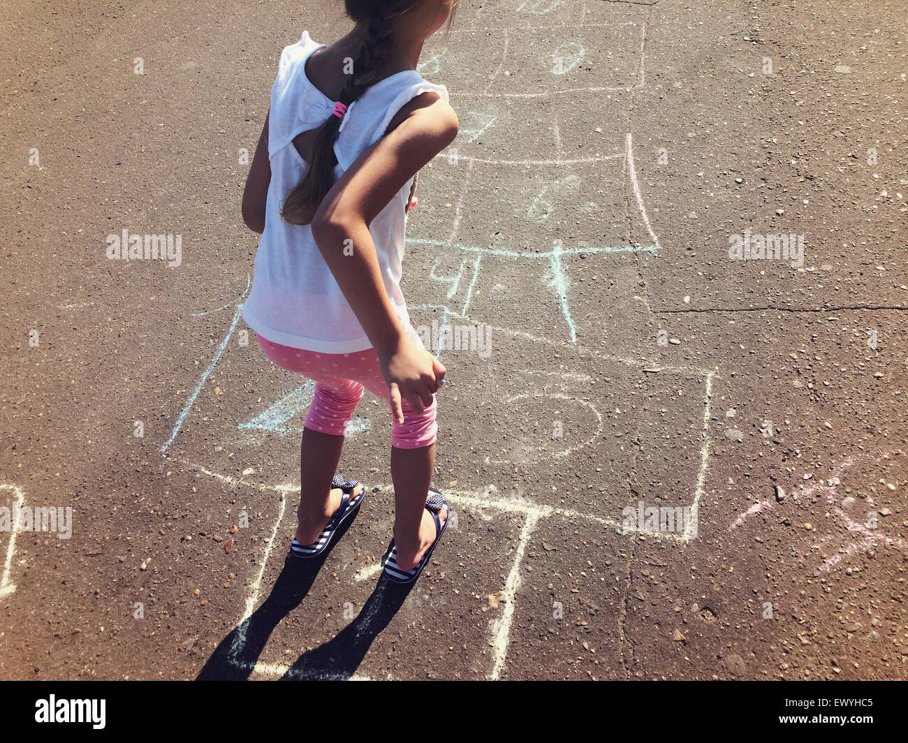 Girl Playing Hopscotch Stock Photo