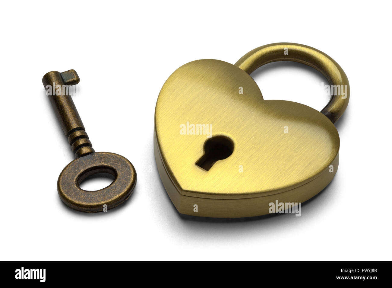 Brass Heart with Key Isolated on White Background. - Stock Image
