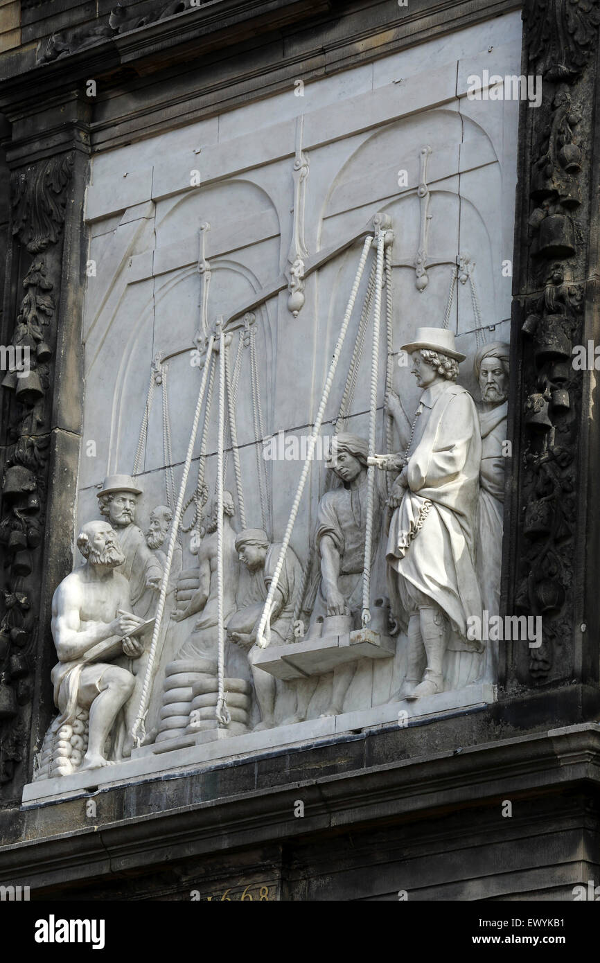 Bas relief depiction of Gouda Cheese Market on the Goudse Waag (the Weigh House) Gouda, the Netherlands. The building - Stock Image