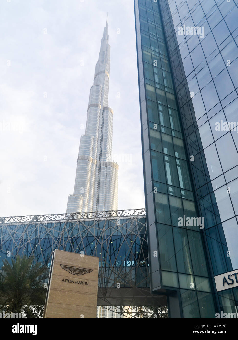 Burj Khalifa, the tallest building in the world in 2015, standing up in Dubai, behind the Aston Martin distributor - Stock Image
