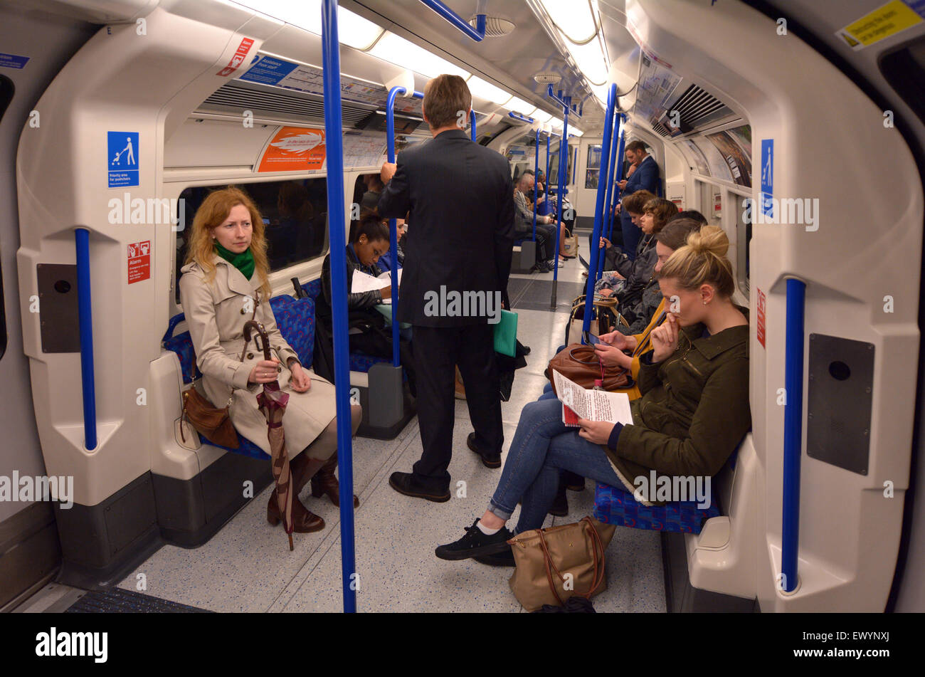 LONDON, UK - MAY 15 2015:Passengers travel on  London Underground. The Annual passenger numbers of london Underground - Stock Image