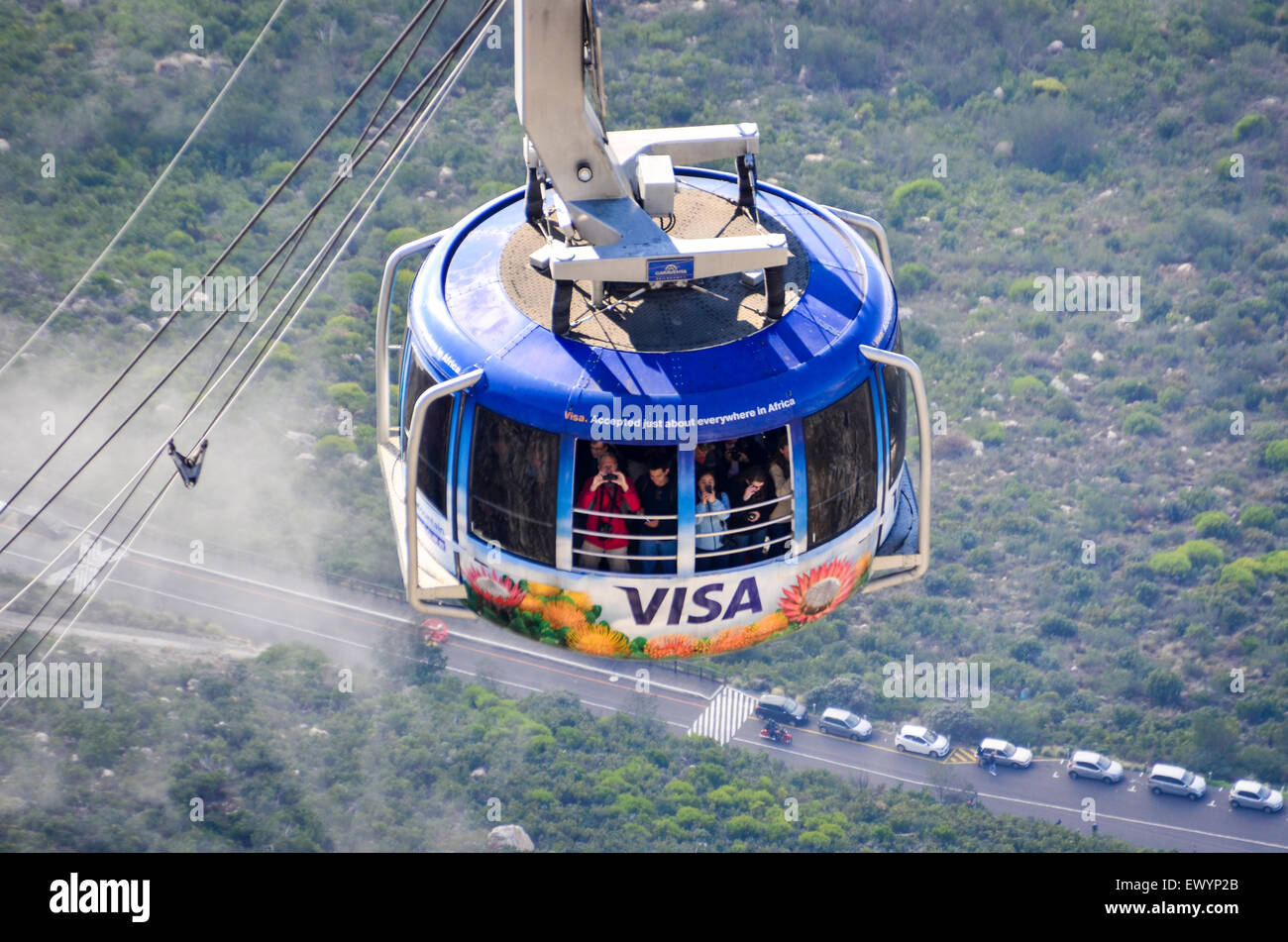 VISA logo on the Cable car of the Table Mountain aerial cableway, Cape Town, rising in the sky above the clouds - Stock Image