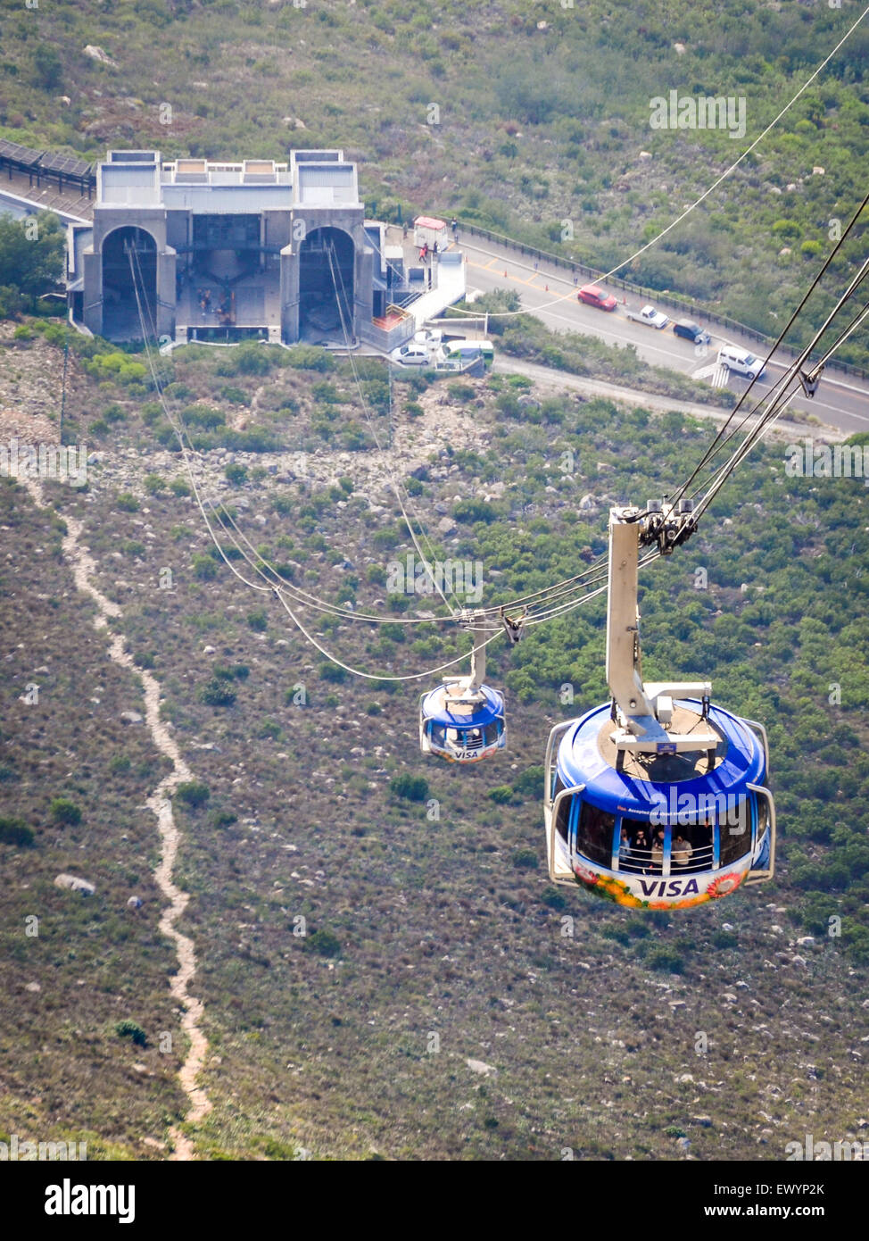 Cable car of the Table Mountain aerial cableway, Cape Town, rising in the sky above the clouds - Stock Image
