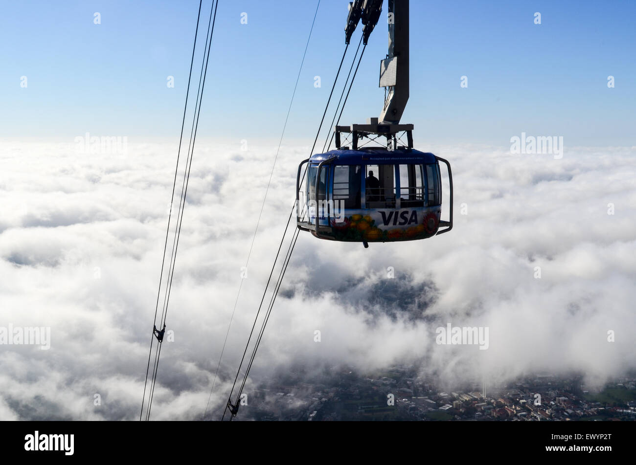 Cable car of the Table Mountain aerial cableway, Cape Town, emerging in the sky above the clouds - Stock Image