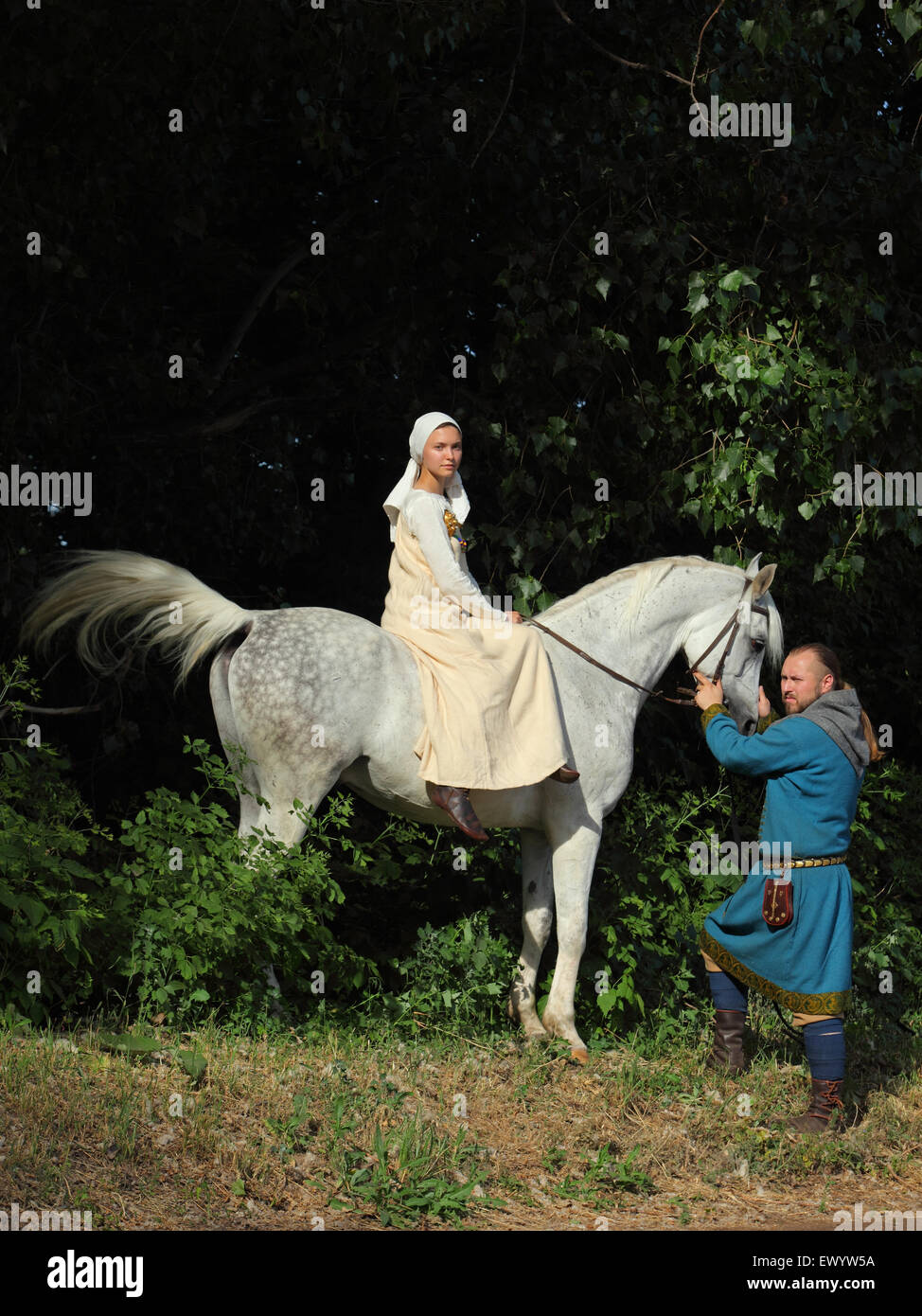 Married Couple Dressed In Clothes Of The Vikings With A Horse Stock Photo Alamy