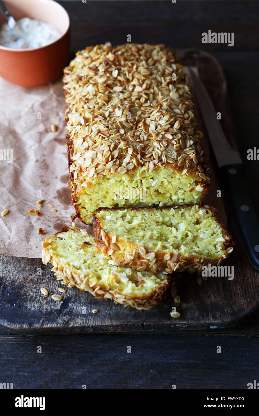 zucchini loaf on rustic table, food closeup - Stock Image