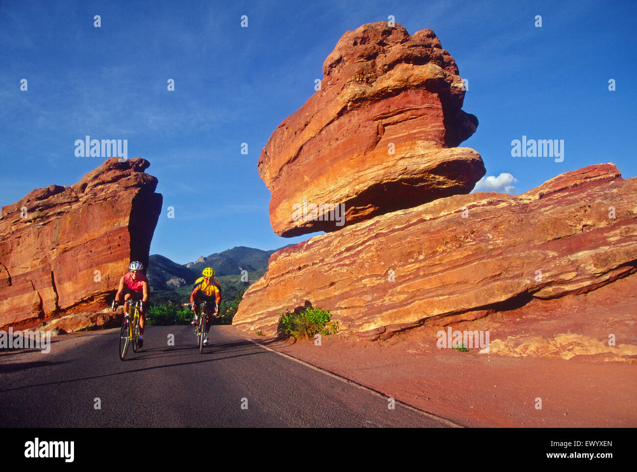 Cindy Burkart & Bruce Ruff cycling in the Garden of the Gods, CO USA Stock Photo