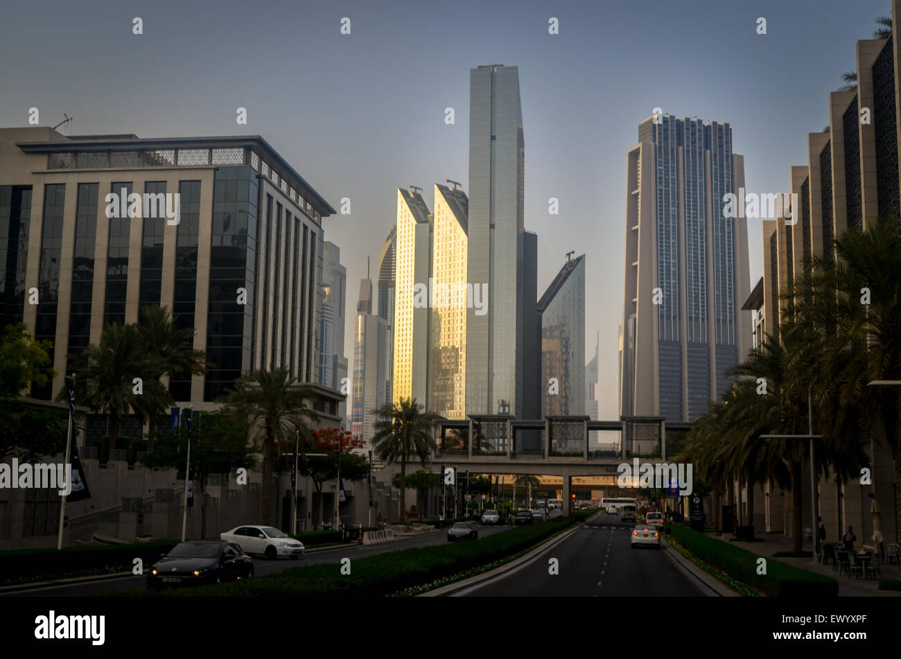Sunset in Downtown Dubai, highway and futuristic buildings - Stock Image
