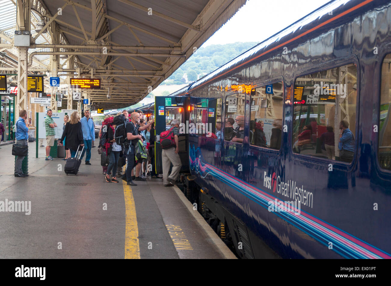 Passengers board a First Great Western train at Bath Spa railway station, Somerset, UK Stock Photo