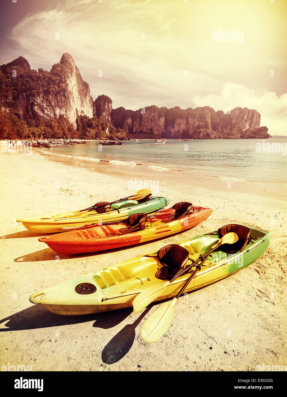 Retro toned kayaks on a tropical beach. Active holidays background. - Stock Image