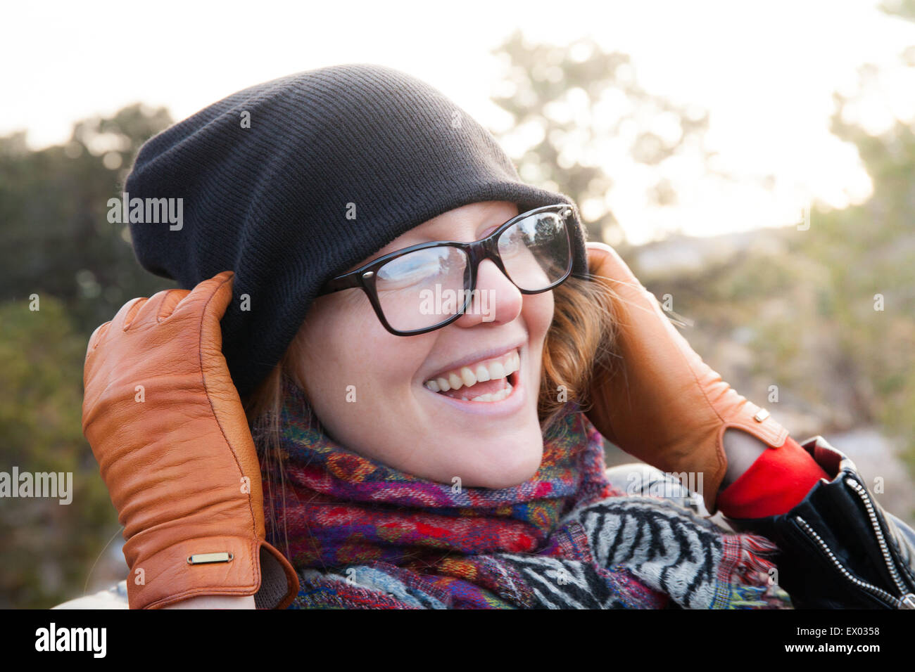 Close up of woman wearing knit hat and scarf - Stock Image