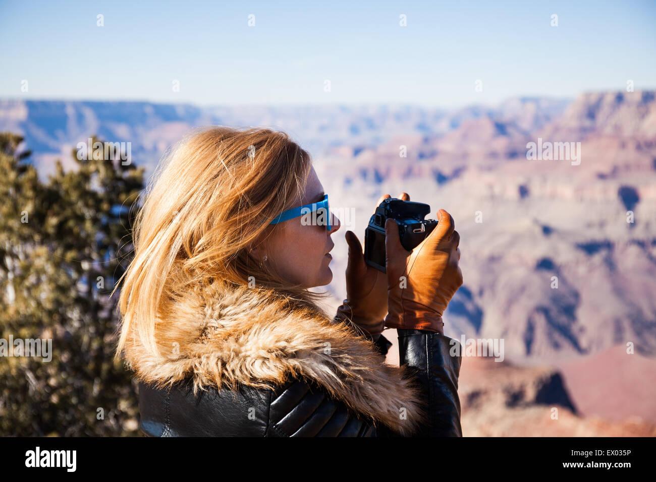 Woman photographing Grand Canyon, Arizona, USA - Stock Image