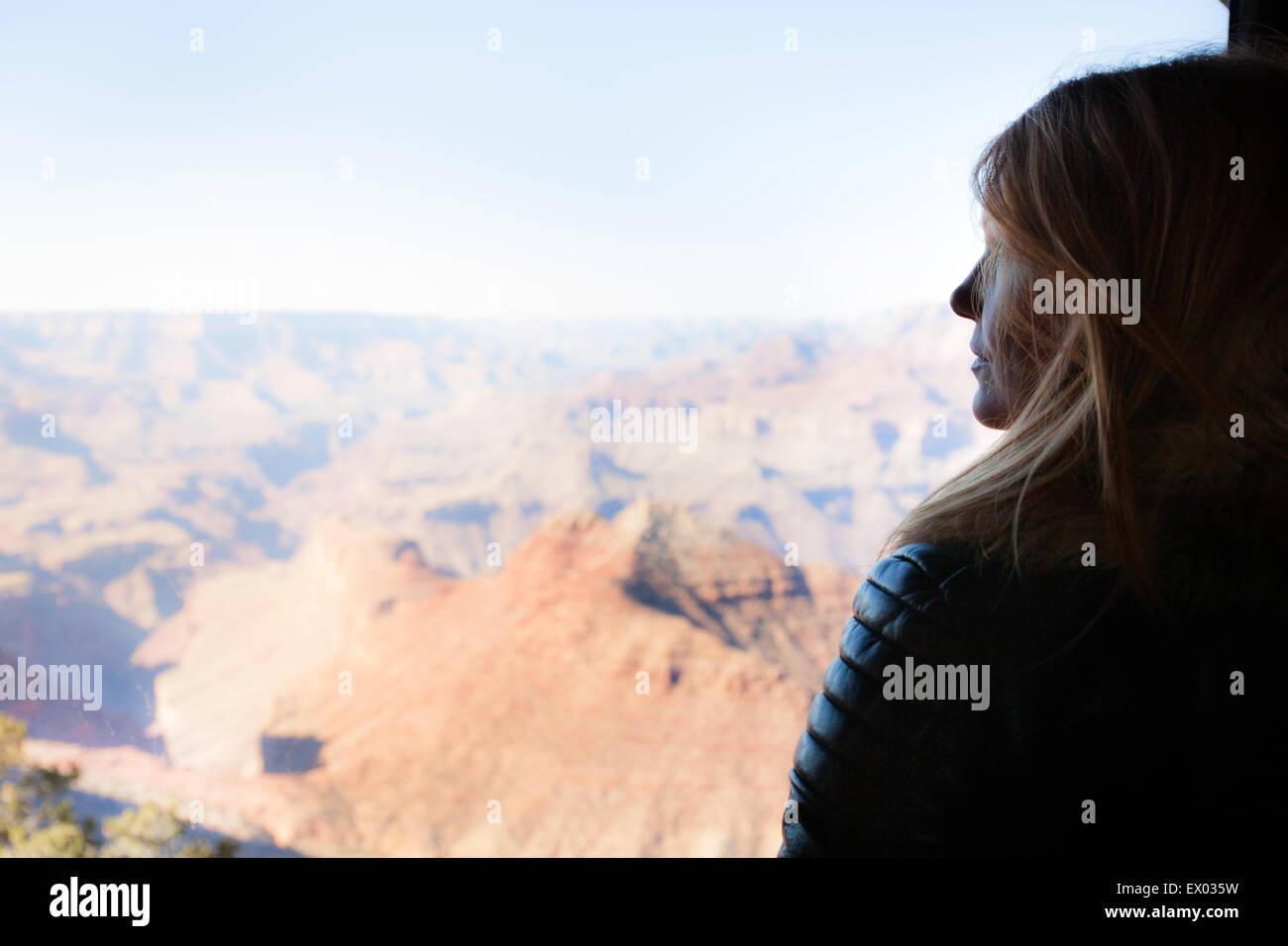 Woman gazing at Grand Canyon, Arizona, USA - Stock Image