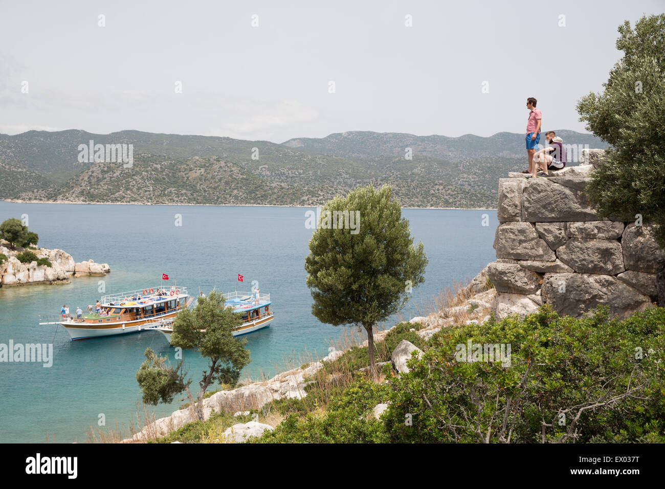 Two men looking out at coast on the Lycian way, Turkey - Stock Image