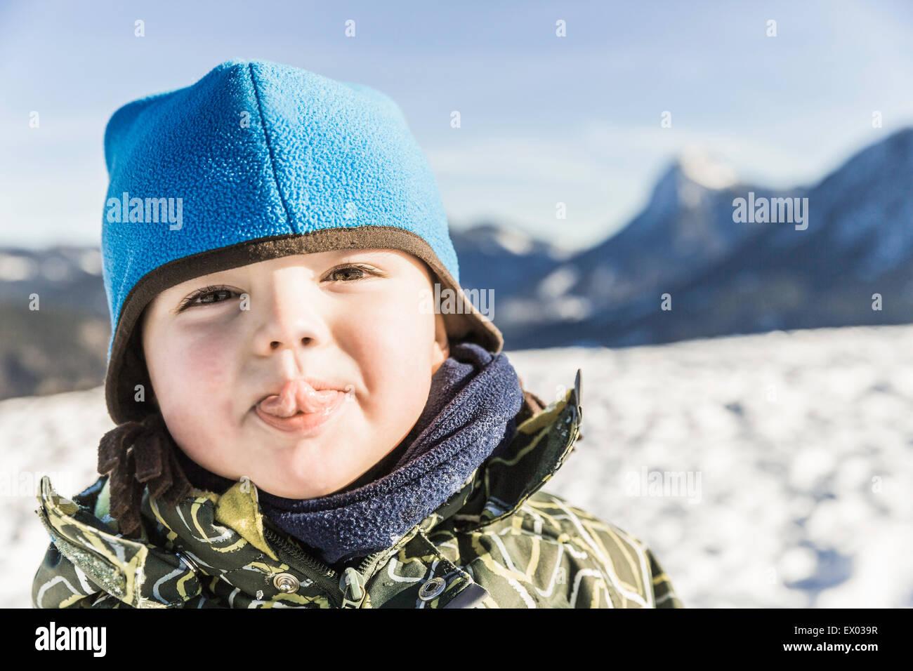 Toddler sticking out tongue, Achenkirch, Tirol, Austria - Stock Image