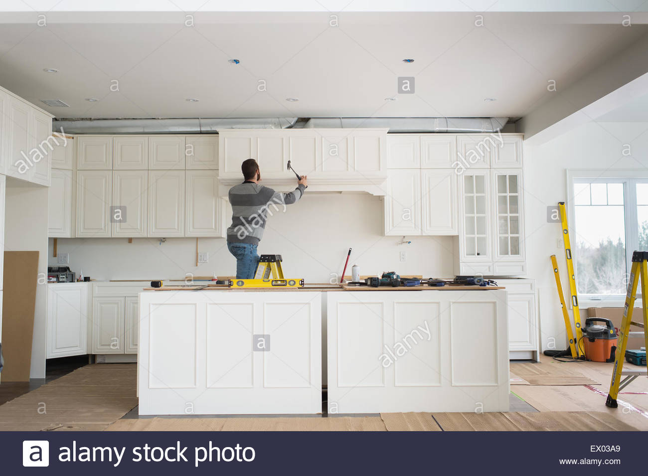 Carpenter Installing Kitchen Cabinet