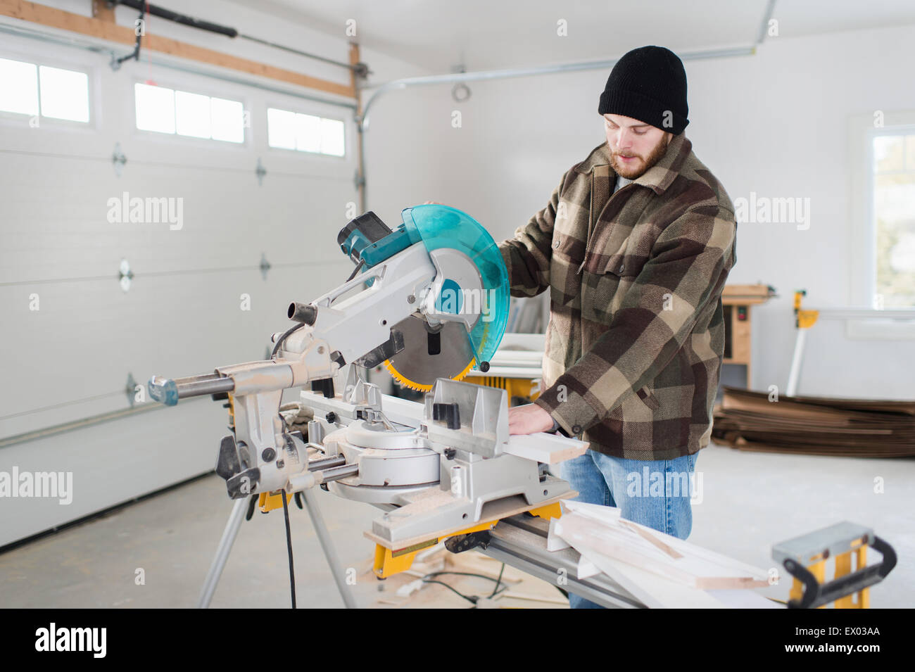 Carpenter working with power tools - Stock Image