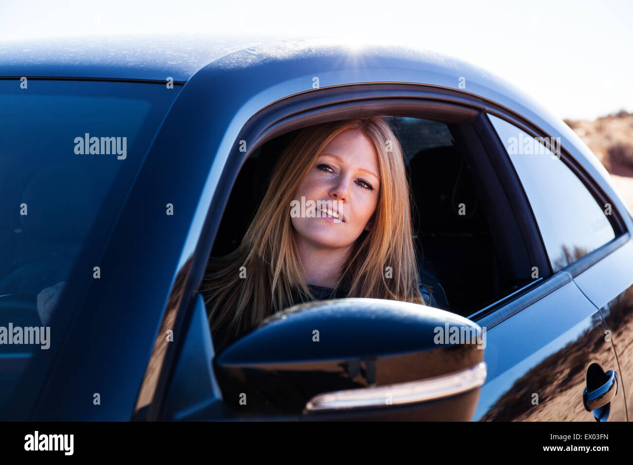 Woman sitting in car - Stock Image