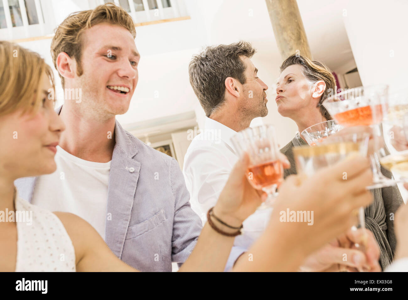 Family making a toast at birthday party - Stock Image