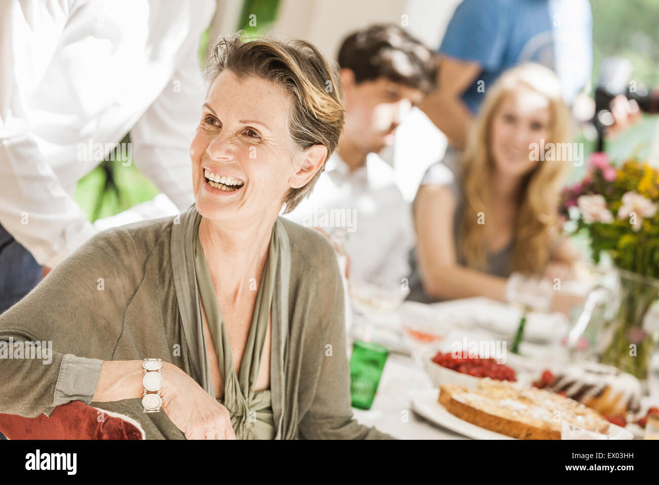 Senior woman at family birthday party in dining room Stock Photo