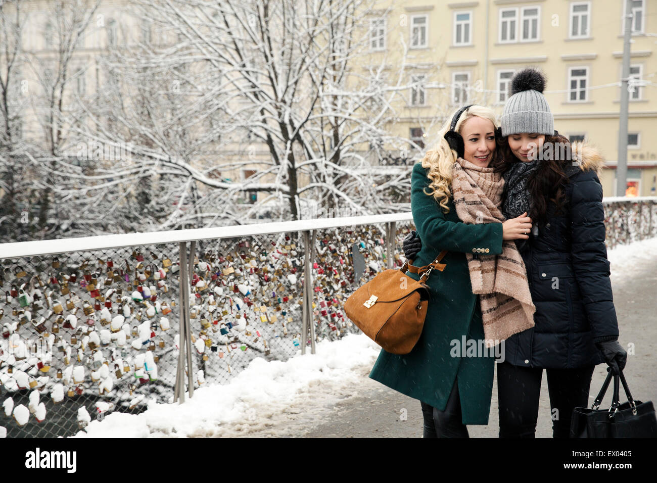 Two mid adult women wearing winter clothes - Stock Image