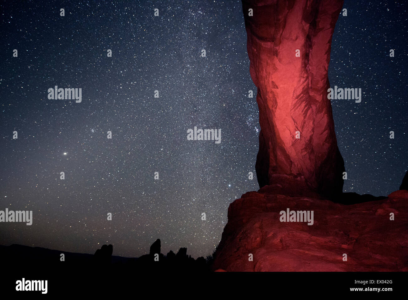 Column rock formation and starry night sky, Arches National Park, Moab, Utah, USA Stock Photo