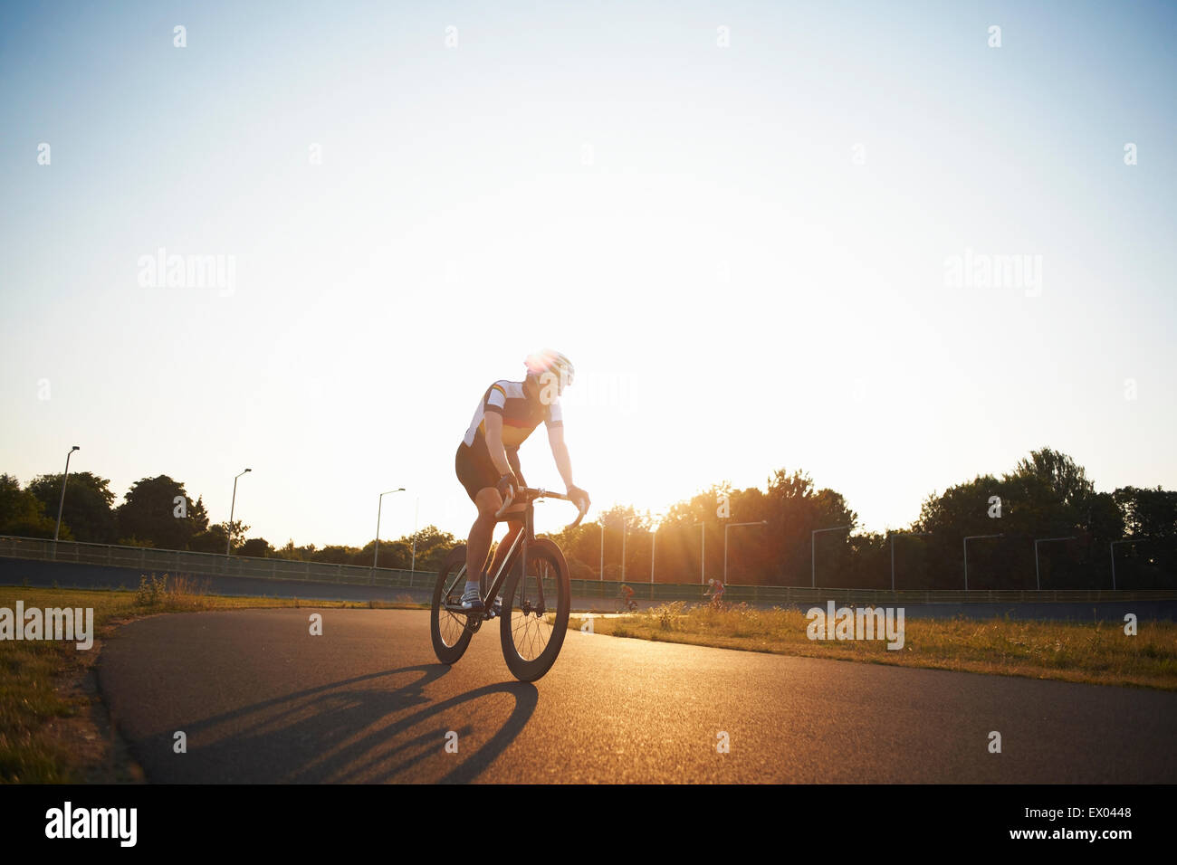 Cyclists cycling on track, outdoors - Stock Image