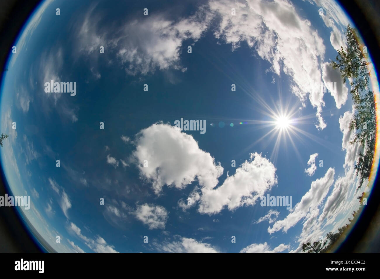cumulus clouds and the sun - Stock Image