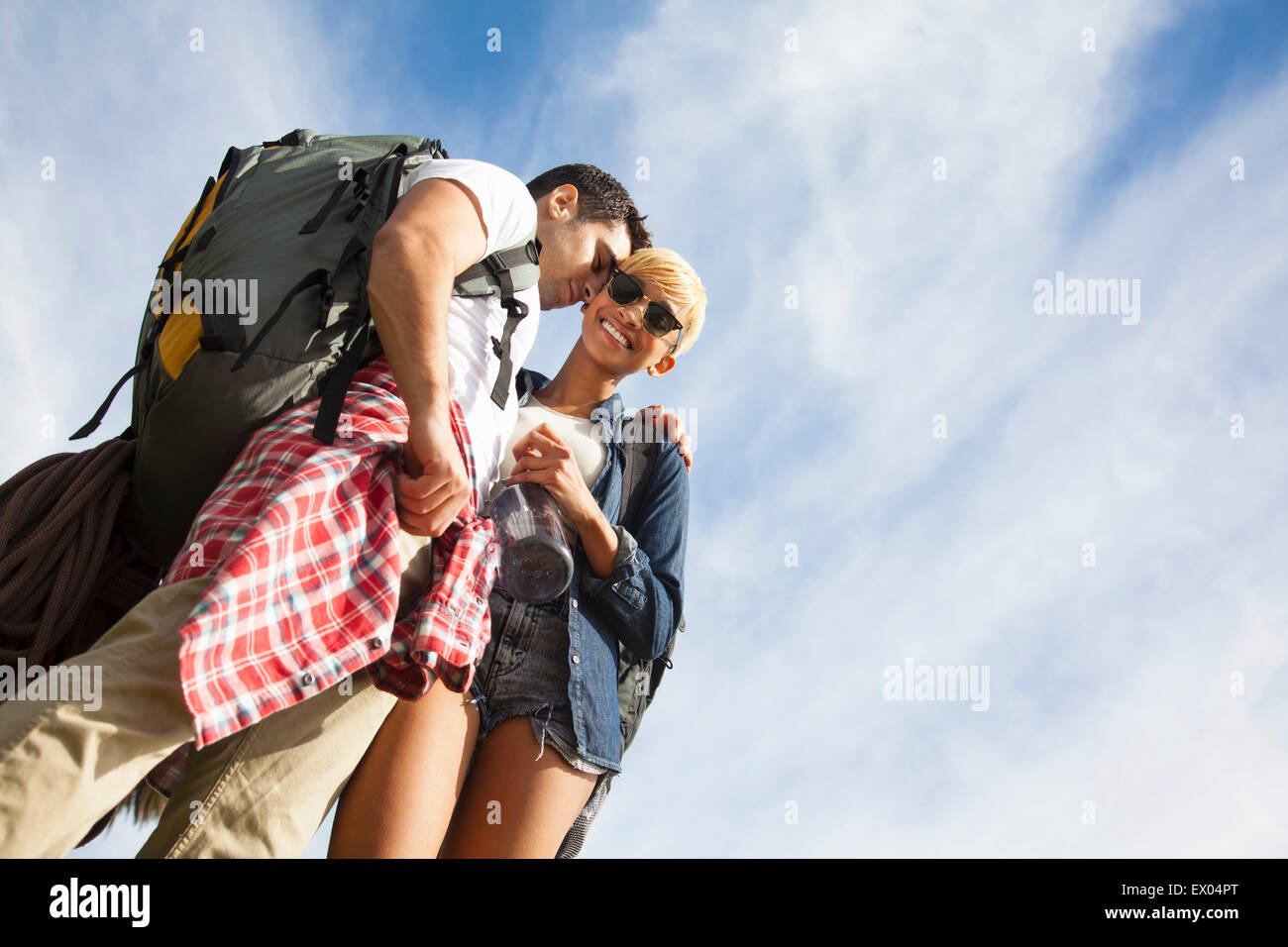 Young couple, outdoors, flirting, low angle view - Stock Image