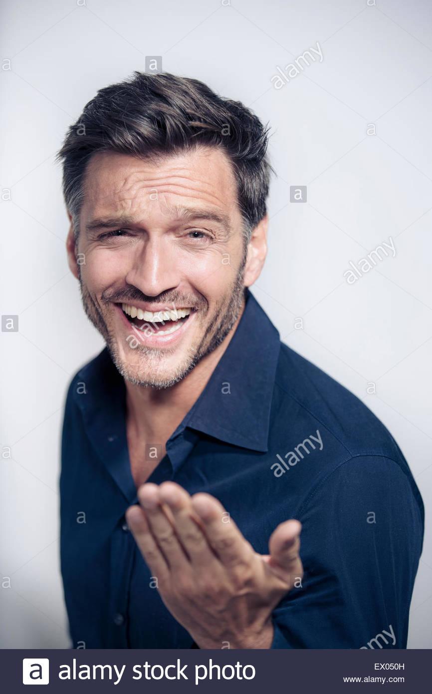 Portrait of mature man gesturing - Stock Image