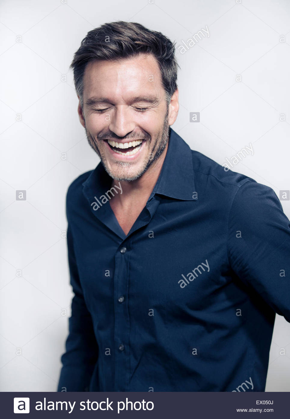 Portrait of mature man laughing - Stock Image