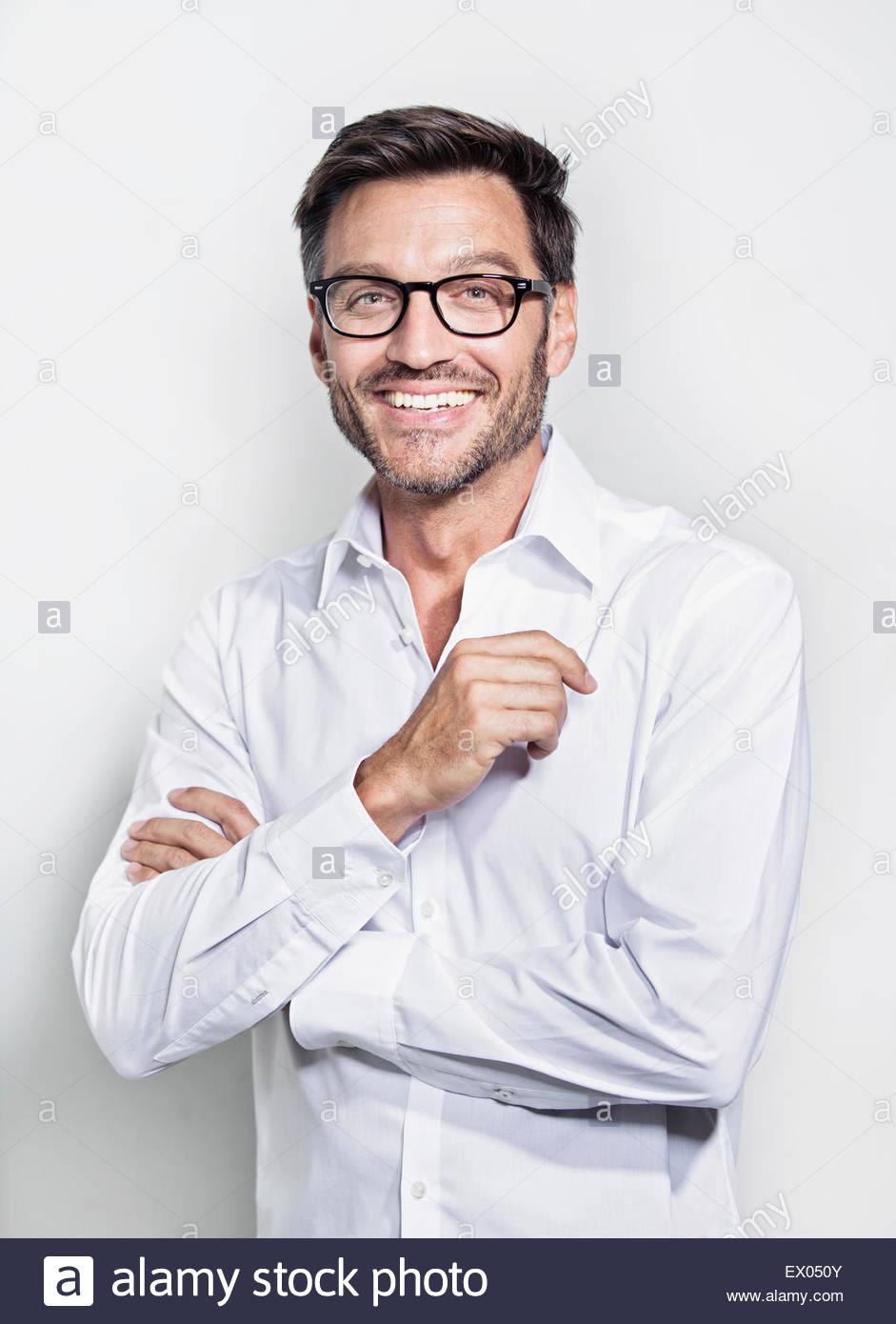 Portrait of mature man wearing glasses - Stock Image