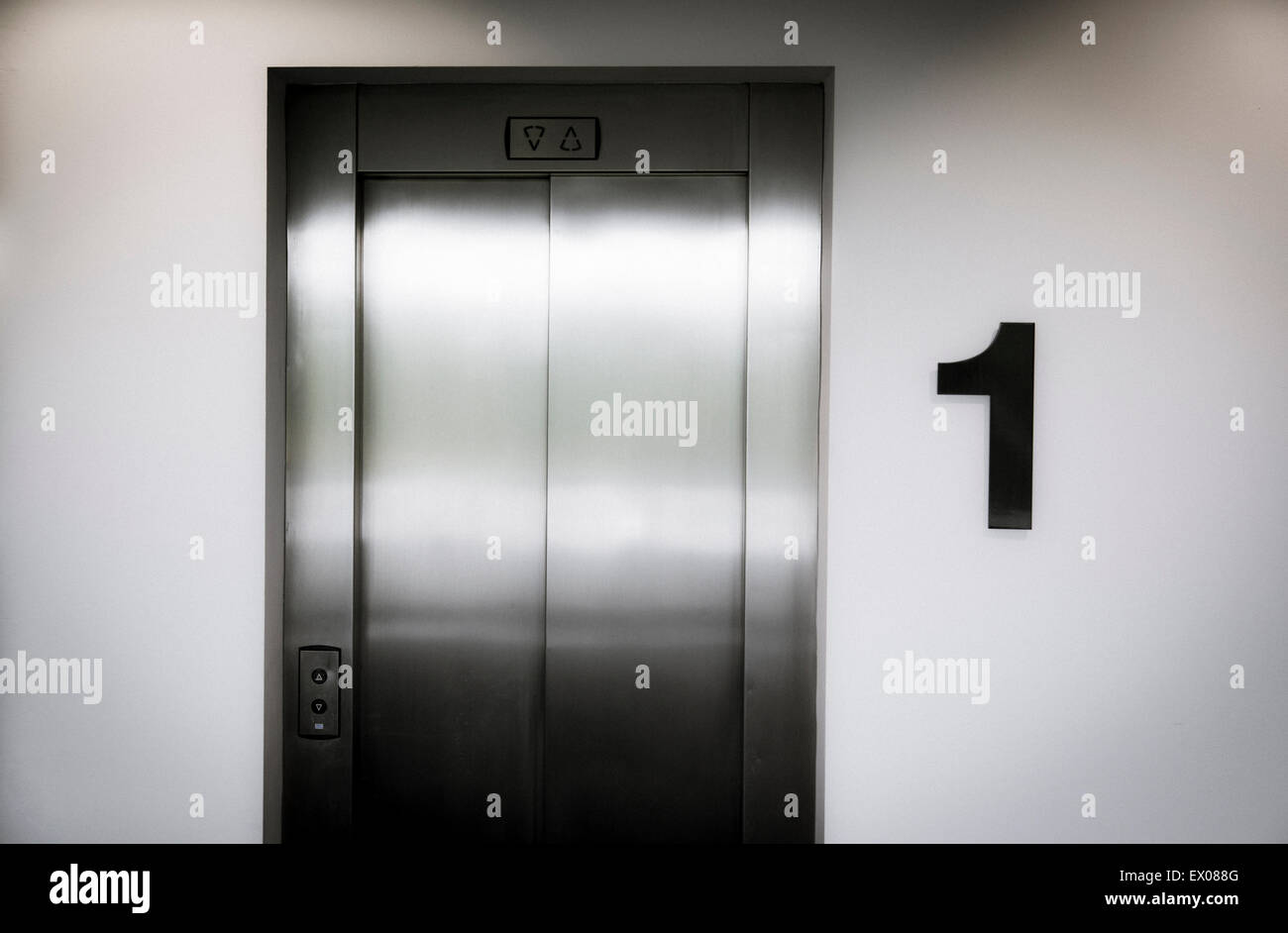 A lift door on the first floor of an office building - Stock Image