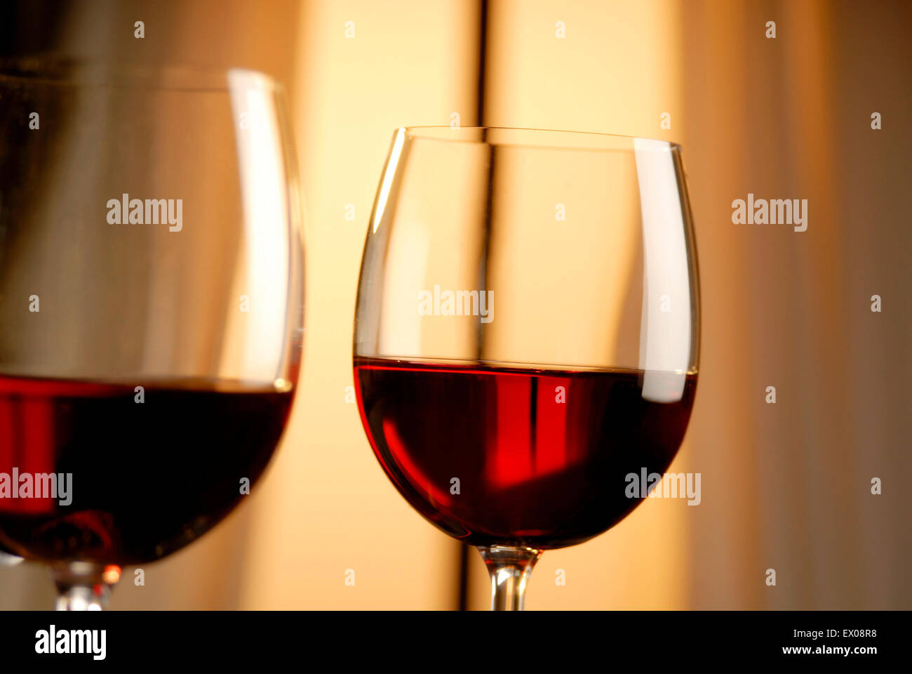 Two glasses of red wine in evening mood Stock Photo