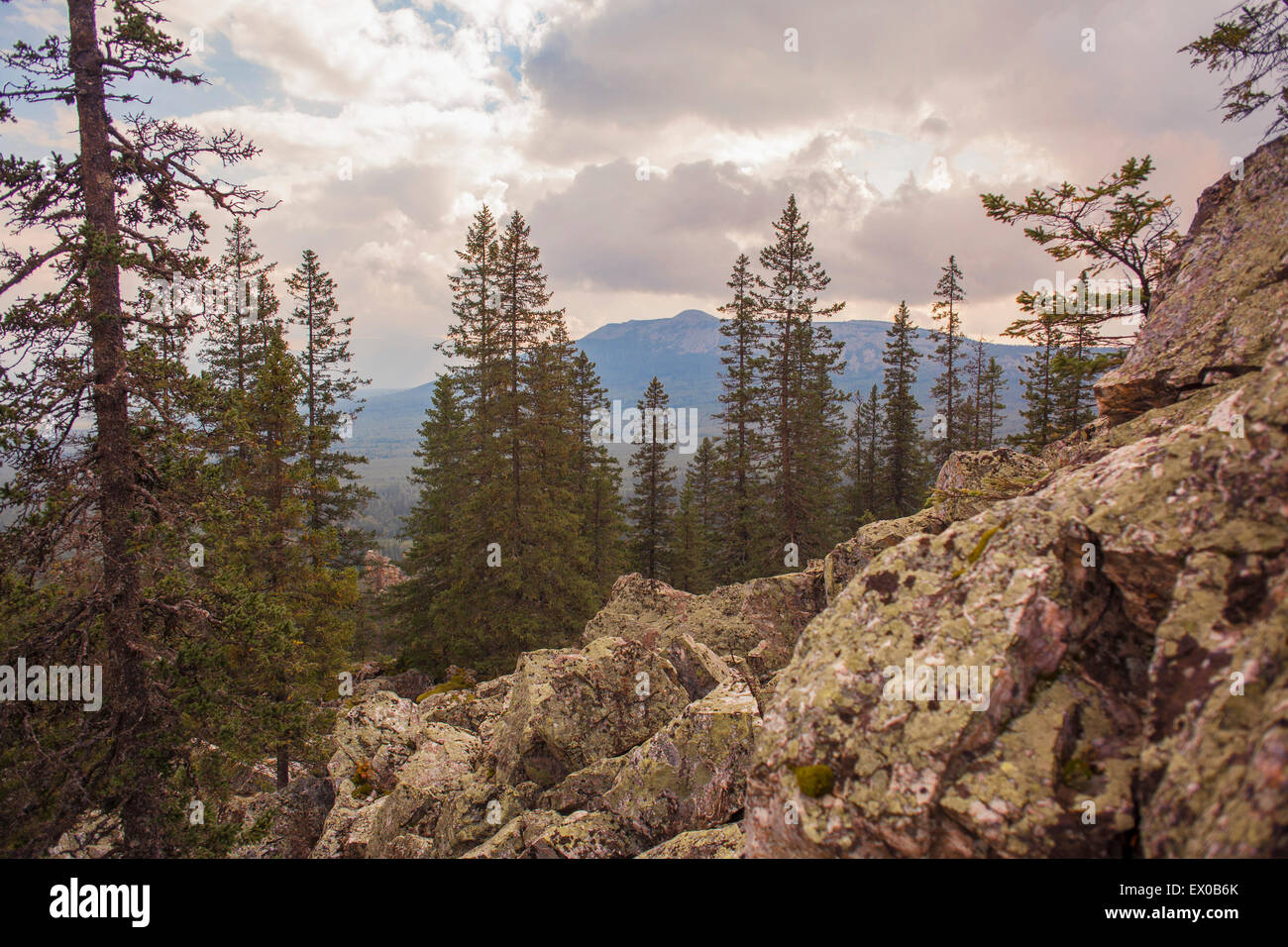 View of rocks, forest and distant mountains, Sarsy Village, Sverdlovsk Oblast, Russia - Stock Image