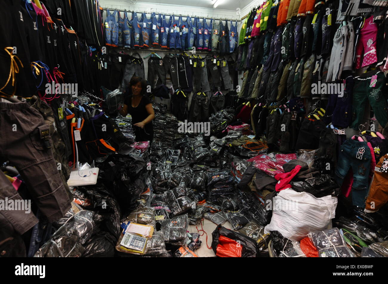 A clothes vendor naps while waits for customers at store in Changzhi, Shanxi province September 1, 2009. VCP - Stock Image