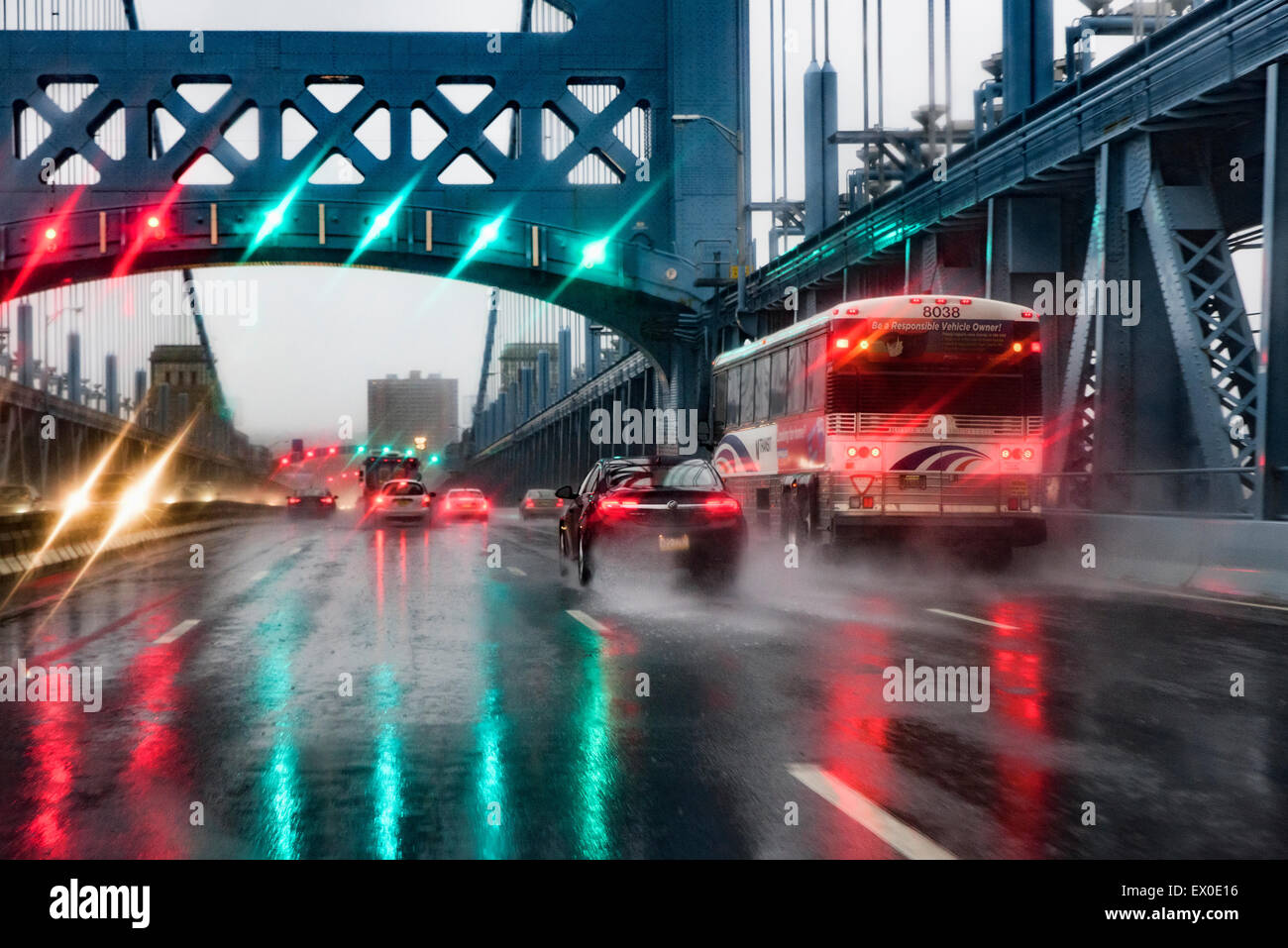 Hazardous driving conditions on a busy bridge during a heavy rain storm. - Stock Image